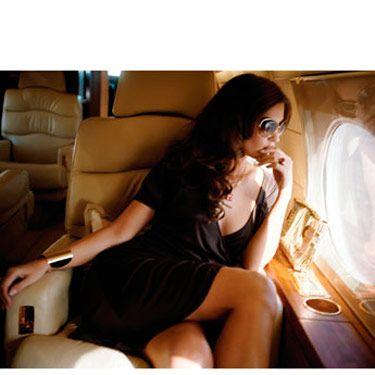 Dress, Diane von Furstenberg, $365&#x3B; sunglasses, Oliver Peoples&#x3B; bag and cuff, Michael Kors&#x3B; necklace, Thalia Jewelry&#x3B; ring, ASHA by ADM