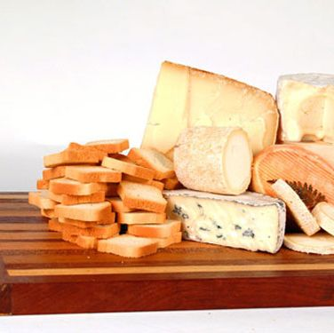 "A delicious gift from the heart of France, this beautifully packaged collection of fine cheeses features luxurious Chaource, fern-adorned Grès des Vosges,  and toasty Ossau-Iraty.  Simply delightful.  $75 at <a href=""http://www.murrayscheese.com/prodinfo.asp?number=50011"" target=""_blank"">murrayscheese.com</a>"