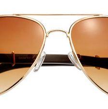 """I often wear my aviators.""<br><br>Sunglasses, Shop Suey, $14, shopsueyboutique.com"