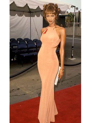 Shoulder, Dress, Joint, Style, Formal wear, Flooring, Amber, Bangs, Tent, Neck,