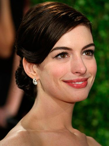 She can act, she can sing (who knew?), and Anne Hathaway can pull off an updo with style.