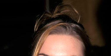 Shortly after her <i>Titanic</i> success, Kate rocked this updo with swept bangs.