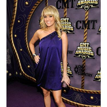 Earlier this year the country crooner confessed to Cosmo that she doesn't consider herself sexy, but we'd beg to differ. Carrie knows how to work the red carpet <i>and</i> her killer legs.