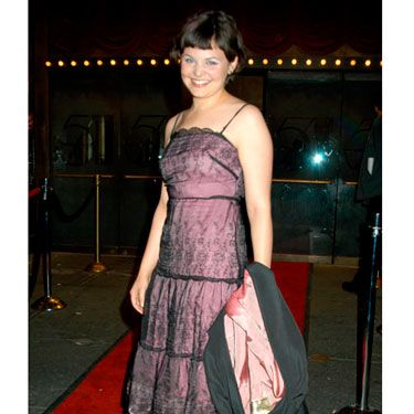 Ginnifer mixes a girly pink color with some sexy black lace.