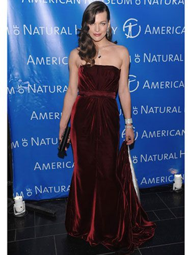 Milla looks lovely in a deep-red gown at the Museum of Natural History.