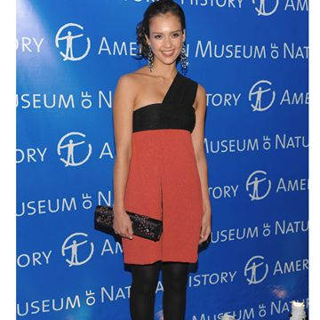 Jessica attends an event at the Museum of Natural History in New York in a sexy coral and black one-shoulder dress.