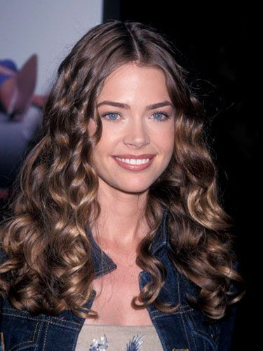 The <i>Wild Things</i> star's thick, spiral curls bring out the shine in her chestnut hair.