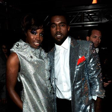 "Looking sharp in silver, the pair snapped up a Grammy for Best Rap/Sung Collaboration for ""American Boy."""