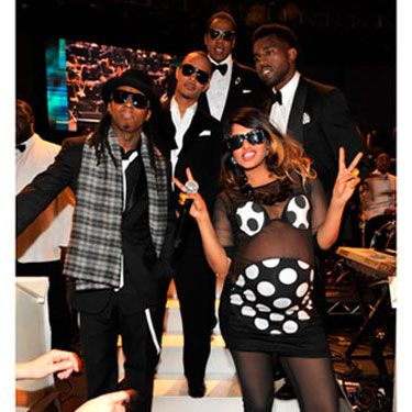 "A very pregnant M.I.A. took to the stage with the boys for a performance of ""Swagga Like Us."""