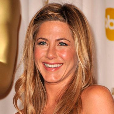 "Makeup artist Angela Levin wanted Jennifer Aniston to look luminous and sunkissed. Her trick: Prep your skin with a light moisturizer like <a href="" http://uma.chanel.com/-skin-care-precision-hydration-hydramax-active-creme-hyration-active-active-moisture-cream-/product/SKPRE5BP"" target=""_blank"">Chanel Hydramax + Active Moisture Boost Cream</a> before using a foundation brush to blend a sheer base all over. Instead of a traditional blush, dab a bit of lipstick like <a href=""http://uma.chanel.com/-makeup-lips-lipstick-rouge-hydrabase-creme-lipstick-/product/MALPR010"" target=""_blank"">Chanel Hydrabase Lipstick in Coco Red</a> onto the apples of your cheeks and a shimmery liquid bronzer around the tops of your cheekbones."