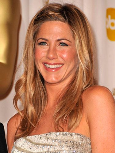 """Makeup artist Angela Levin wanted Jennifer Aniston to look luminous and sunkissed. Her trick: Prep your skin with a light moisturizer like <a href="""" http://uma.chanel.com/-skin-care-precision-hydration-hydramax-active-creme-hyration-active-active-moisture-cream-/product/SKPRE5BP"""" target=""""_blank"""">Chanel Hydramax + Active Moisture Boost Cream</a> before using a foundation brush to blend a sheer base all over. Instead of a traditional blush, dab a bit of lipstick like <a href=""""http://uma.chanel.com/-makeup-lips-lipstick-rouge-hydrabase-creme-lipstick-/product/MALPR010"""" target=""""_blank"""">Chanel Hydrabase Lipstick in Coco Red</a> onto the apples of your cheeks and a shimmery liquid bronzer around the tops of your cheekbones."""