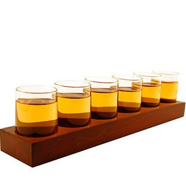 "Any connoisseur of fine spirits would be glad to receive six 2.25-ounce shot glasses housed in a stylish wood rack. Whether he chooses to enjoy it by himself, with you, or with friends, you can't go wrong with this gift (especially for the price). Available for $20-$25 at <a href=""http://www.uncrate.com/men/home/drinkware/liqueur-tasting-shot-glasses/"" target=""_blank"">uncrate.com</a>."