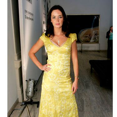 The English actress shows off her amazing body in a flirty yellow dress.