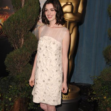 During Oscar season, Anne decked herself out in gold with shiny pumps to match her embroidered dress.