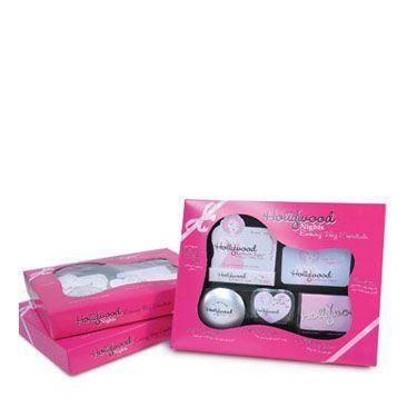 "Complete with fashion tape, oil-blotting sheets, make-out mints, and lighted mirror, this set is perfect for a little pre-date — or between-date — pick-me-up. Hollywood Nights Evening Bag Essentials set by Hollywood Fashion Tape, $10, available at <a href=""http://www.amazon.com/Hollywood-Fashion-Nights-Evening-Essentials/dp/B00119OK82"" target=""_blank"">amazon.com</a>."