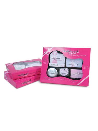 """Complete with fashion tape, oil-blotting sheets, make-out mints, and lighted mirror, this set is perfect for a little pre-date — or between-date — pick-me-up. Hollywood Nights Evening Bag Essentials set by Hollywood Fashion Tape, $10, available at <a href=""""http://www.amazon.com/Hollywood-Fashion-Nights-Evening-Essentials/dp/B00119OK82"""" target=""""_blank"""">amazon.com</a>."""