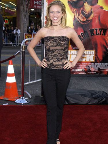 The actress's lace tube top flatters her slender waist.