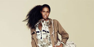 <b>a printed blouse and a printed bag together.</b><br /><br />   Jacket, blouse, pants, and  shoes, Gucci; bag, Miu Miu;  bangles, Louis Vuitton