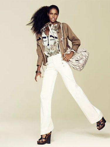 <b>a printed blouse and a printed bag together.</b><br /><br />   Jacket, blouse, pants, and  shoes, Gucci; bag, Miu Miu;  bangles, Louis Vuitton
