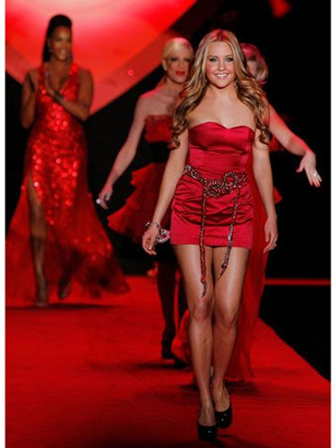 """As the first celebrity model to walk down the runway (to Beyoncé's """"Single Ladies""""), actress Amanda Bynes also led the pack at the end of the show."""