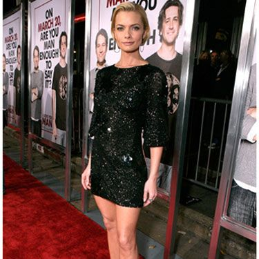 Jaime shines in a sequined black minidress and matching strappy 