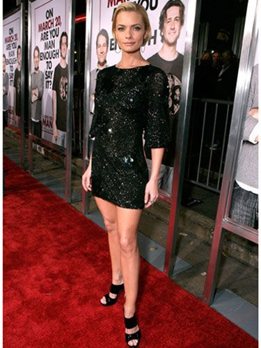Jaime shines in a sequined black minidress and matching strappy  sandals.