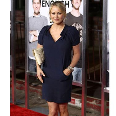 Christine's style is L.A. casual yet polished in a navy blue minidress at 