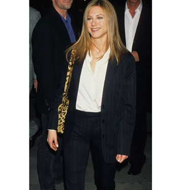 Jen looks <i>Picture Perfect</i> in a polished pinstripe suit.