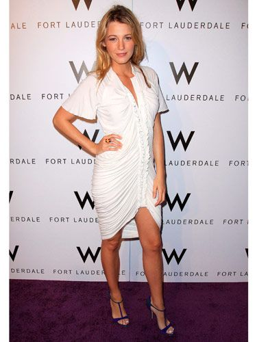Spotted: Blake Lively sizzles in a ruffled Christian Cota dress and thin-strap purple heels.
