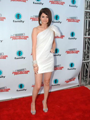 Selena Gomez sported a silk one-shoulder dress  and silver heels at the premiere of Disney's <i>Princess Protection Program</i> in Toronto.