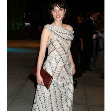Zooey complements a busy geometric dress with a simple clutch.