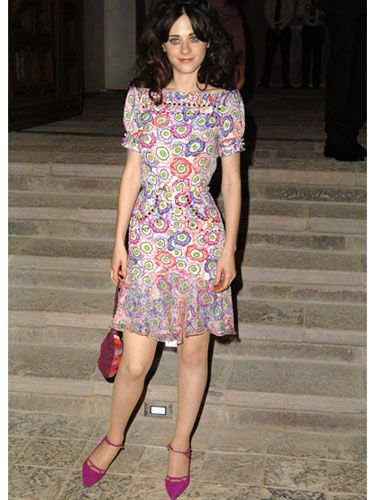 Zooey goes for a pop art look with her magenta shoes and multicolor patterned dress.