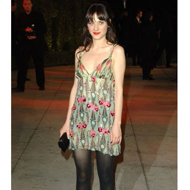Zooey shows off her amazing legs in a short dress at the Vanity Fair Oscars party.