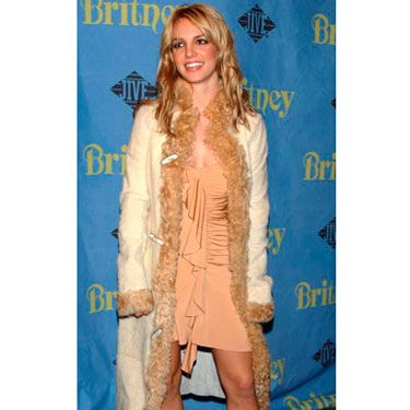 The Louisiana girl brought her boots and playful style to her <i>Britney</i> album release party.