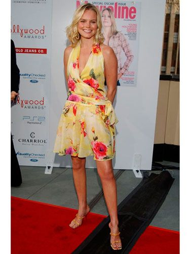 Fresh off her first starring role in <i>Blue Crush,</i> the young actress shows off her beach glow in a floral frock and loose blond waves.