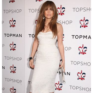 JLo works her famous curves in a skintight white dress and some seriously sexy heels.