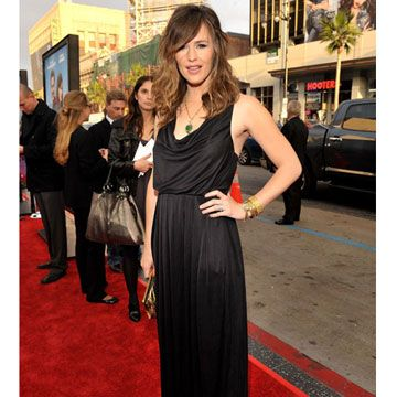 Jen looks like a goddess in this Rachel Roy cowlneck gown, gold bangles, and an emerald drop necklace.