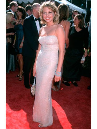 Michelle went glam for the Emmy Awards in a pink strapless gown that hugged her curves in all the right places.