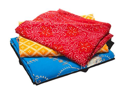 "Intricate ethnic cloths can add major flair. Place one at the foot of your bed, fold it in half over a curtain rod for a unique window shade, or drape one over a table as a runner. Go to <a href=""http://www.sarishop.com"" target=""_blank"">sarishop.com</a>, or visit a fabric store for a few yards of exotic-looking material.<br /><br /><i>Yellow sari, $12, and red sari, $20: India Sari Palace, Jackson Heights, N.Y., 718-426-2700; blue sari: $30, Rahul, Jackson Heights, N.Y., 718-205-1987</i>"