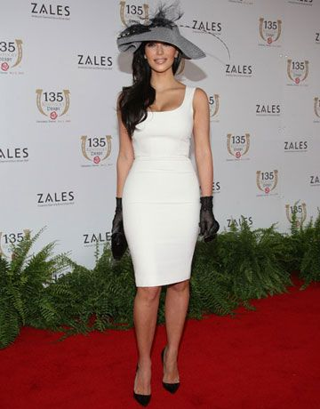Hats off to this reality TV star for pairing adorable headwear with chic wrist-length gloves.