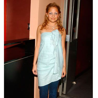 Wrapped in a baby blue pashmina and denim, Nicole attended a martini party in 