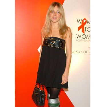 In a black strapless dress and green velvet boots, Sienna embodied the bohemian style she helped make famous.