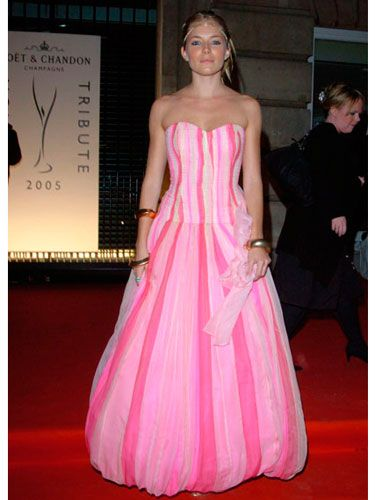 Sienna donned a striped ballgown in shades of pink for a fashion tribute in London.