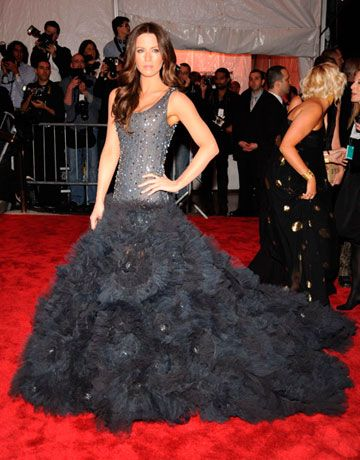Opting to take a walk on the wild side, Kate wore an embroidered midnight blue ruffle tulle tank dress by Marchesa.