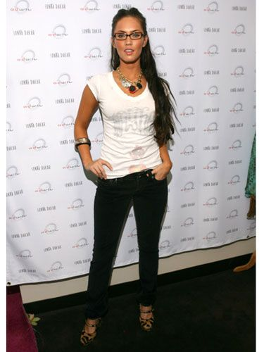 Keeping it casual in a white top, black jeans, and sexy leopard print heels, the actress attends a party in Los Angeles.