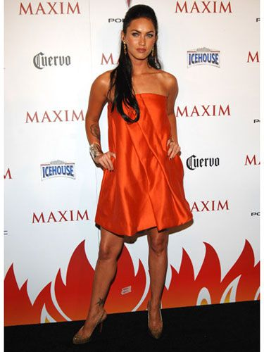 Megan is smoking-hot in an orange dress at a party in New York City.