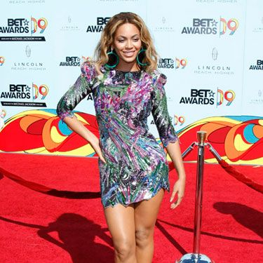 Beyoncé was one of the fiercest celebs on the red carpet at the BET awards in L.A.  She showed off her killer legs in an original floral sequin minidress and purple T-strap heels.