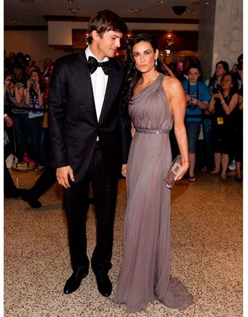 Demi shows off her amazing figure in a one-shoulder lavender gown. No wonder Ashton can't take his eyes off of her!