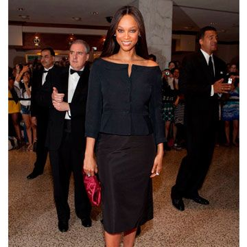 Tyra has been known to push the envelope on the red carpet, but still looks sexy in this simple black suit.