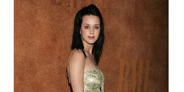 At the Pop Awards in Beverly Hills, Katy strikes a pose in a sleek metallic dress.